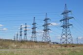stock photo of power transmission lines  - The photo of spring landscape with power line Russia - JPG