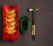 pic of deep  - traditional Vietnam deep fried shrimp and pork rolls in breadcrumbs served on a black background - JPG