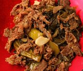 picture of stir fry  - Vietnamese beef stir fry close up on a red background - JPG