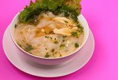 foto of glass noodles  - Glass noodle soup with chicken and beansprouts on a pink background - JPG