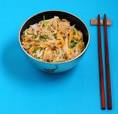 pic of rice noodles  - Vietnamese vermicelli chicken and rice noodles soup pho on a blue background - JPG