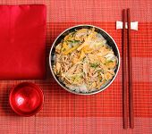 stock photo of rice noodles  - Vietnamese vermicelli chicken and rice noodles soup pho served on a bamboo place mat - JPG