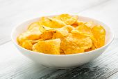 image of potato chips  - Hearty potato chips served in a bow. ** Note: Shallow depth of field - JPG