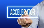 image of acceleration  - Business concept image of a businessman clicking Accelerator button on virtual screen over blue background - JPG