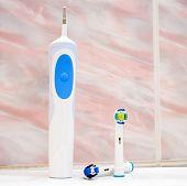 foto of toothbrush  - Electric toothbrush in the bathroom - JPG