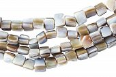 foto of agate  - Strings of agate beads isolated over white - JPG