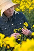 pic of cultivation  - Female Farmer in Oilseed Rapeseed Cultivated Agricultural Field Examining and Controlling The Growth of Plants Crop Protection Agrotech Concept - JPG