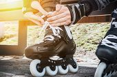 image of inline skating  - dressing roller skates for skating - JPG