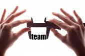 foto of calipers  - Color horizontal shot of two hands holding a caliper and measuring the word  - JPG