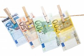 picture of pegging  - Euro banknotes hanging with peg from a rope isolated on white background - JPG