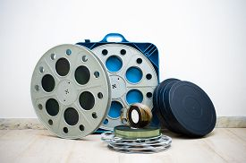 pic of mm  - Heap of old 35 mm cinema movie reels with blue professional boxes - JPG