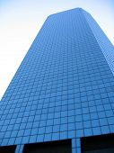 Modern Office Building Against Blue Sky. poster