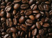 picture of colombian currency  - close up of piled roasted coffee beans - JPG