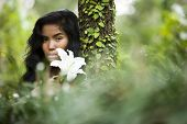 stock photo of pacific islander ethnicity  - Face of beautiful woman of Pacific Islander ethnicity 20 years in the woods - JPG