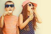 Kids Boy And Little Girl Eating Ice Cream. poster