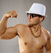 picture of gangster necklace  - Picture of a stylish man in white hat - JPG