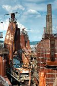 stock photo of blast-furnace  - An old decaying steelworks rusting and rotting with blast furnace - JPG