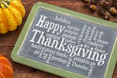 Happy Thanksgiving word cloud on a vintage slate blackboard with winter squash poster