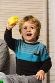Kid Plays With Colorful Plastic Blocks. Toddler With Curious Face poster