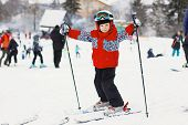 Little Cute Boy With Skis And A Ski Outfit. Little Skier In The Ski Resort poster
