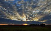 Beautiful Sky With Clouds At Sunset And The Rays Of The Sun poster