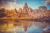 Angkor Wat Temple in Cambodia reflected in lake. Largest religious monument complex in the world. An poster