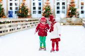 Kids Ice Skating In Winter. Ice Skates For Child. poster