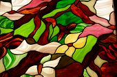 image of stained glass  - Colorful stained glass window backlighted to enhance the colors - JPG
