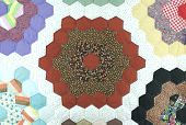 picture of scrappy  - Handmade colorful padded pattern patchwork folksy multicolored quilt - JPG
