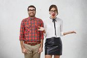 Awkward Funny Unshaven Male Geek Stands Next To Beautiful Female With Red Lips, Doesn`t Know How To poster