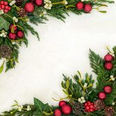 Christmas festive background border on parchment paper with red bauble decorations, holly, mistletoe poster