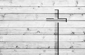 White old christian religion symbol cross shape as sign of belief on a grungy textured church wall o poster