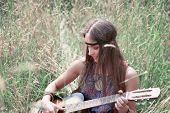 Young Hippie Woman With Guitar Performs A Song poster