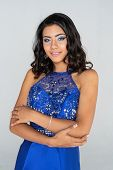 Hispanic prom queen at her high school dance poster