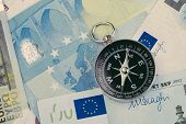 Direction Of Europe And Uk After Brexit Negotiation Concept, Compass On Euro Banknotes With Euro Fla poster