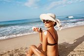 Beautiful Woman Apply Sun Cream On Tanned  Back. Skin And Body Care.sun Protection. Portrait Of Fema poster