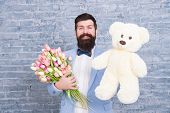 Macho Getting Ready Romantic Date. Waiting For Darling. Man Well Groomed Wear Tuxedo Bow Tie Hold Fl poster