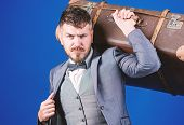 Business Trip With Retro Suitcase. Stylish Esthete With Vintage Bag. Bearded Man In Formal Suit. Hea poster