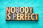 nobody is perfect - word abstract in vintage letterpress wood type printing blocks poster