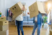Funny couple wearing cardboard boxes with fun crazy emoji faces  poster