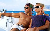 foto of sail-boats  - Beautiful Couple resting on the Yacht - JPG