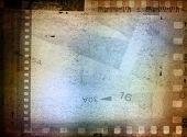 Film negative frames overlapping background poster