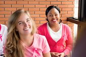 Diverse Group Of Women Wearing Pink Color Clothes With Ribbons Meeting For Breast Cancer Awareness C poster