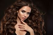 Beautiful Woman With Long Brown Curly Hair. Closeup Portrait With A Pretty Face Of The Young Girl. F poster