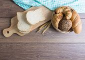 Many Types Of Bread, Including Croissants, Whole Wheat Rolls, Whole Wheat Bread, On A Wooden Cutting poster