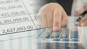 Accounting Business Concept. Business People Using Calculator With Accounting Report And Financial S poster