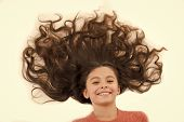 Care That Gives Healthy Beautiful Hair. Girl Cute Child With Long Curly Hair Isolated On White. Hair poster