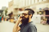 Handsome Sexy Bearded Young Man Hipster With Long Beard And Mustache Has Stylish Hair On Smiling Hai poster