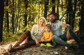 United With Nature. Family Day Concept. Happy Family With Kid Boy Relaxing While Hiking In Forest. B poster
