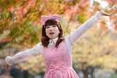 stock photo of lolita  - japanese lolita portrait in park during fall season - JPG